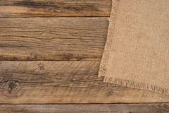 Texture of the old burlap and wood. Stock Image