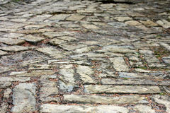 Texture old cobbled pavement Royalty Free Stock Image