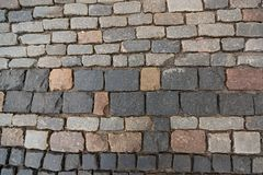 Texture of old colorful square paving stones stock photo