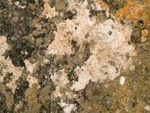 Texture of old concrete. Details of worn and weathered concrete with discoloration Royalty Free Stock Image