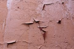 Texture of old cracked brown paint. On wall Stock Photo