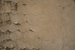 Texture of old cracked painted wall. Texture of old cracked painted peeling beige brown wall background Royalty Free Stock Photography