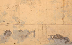 Texture of old cracked yellow wall of large blocks with stucco Royalty Free Stock Photography
