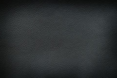 Texture of old crumpled black leather. Royalty Free Stock Photos