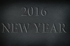 Texture of old crumpled black leather. New year 2016. Royalty Free Stock Image