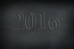 Texture of old crumpled black leather. New year 2016. Stock Photo