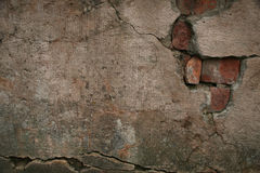 Texture of old damaged brick plaster cement wall. Texture of old damaged brick plaster cement crumbling wall background Stock Image
