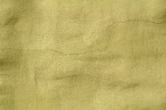 Texture of old damaged wall covered with green stucco Royalty Free Stock Photography