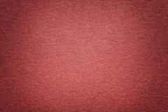Texture of old dark bronze paper background, closeup. Structure of dense cardboard. Texture of vintage dark red paper background with vignette. Structure of royalty free stock images