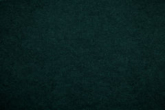 Texture of old dark green paper background, closeup. Structure of dense emerald cardboard.  royalty free stock photography