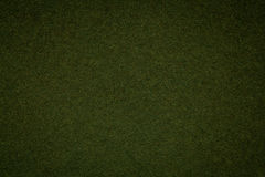Texture of old dark green paper background, closeup. Structure of dense moss cardboard Royalty Free Stock Images