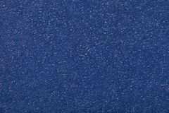 Texture of old dark navy blue paper closeup. Structure of a dense cardboard. The denim background.  stock photos