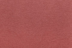 Texture of old dark red paper background, closeup. Structure of dense brown kraft cardboard Stock Image