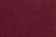 Texture of old dark red paper closeup. Structure of a dense cardboard. The maroon background. Royalty Free Stock Photo