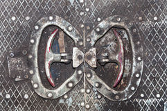 The texture of the old dirty metal floor. Handles for emergency opening the door. Royalty Free Stock Photography