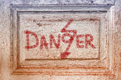 Texture of old door with inscription danger Royalty Free Stock Photos