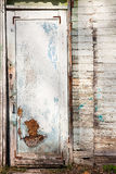 The texture of old door, which the old paint flaking. The textur Stock Images
