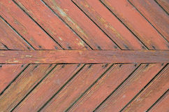 Texture of old doors with boards herringbone Royalty Free Stock Photos