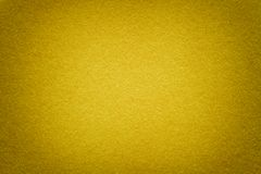 Texture of old golden paper background, closeup. Structure of dense cardboard stock image