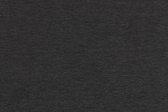 Texture of old gray paper closeup. Structure of a dense cardboard. The black background. Texture of old dark gray paper closeup. Structure of a dense cardboard royalty free stock image