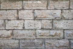 Texture of old gray wall with stone facing Stock Image