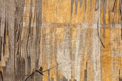 Texture of old gray and yellow plywood royalty free stock image