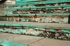 Old green color on a falling staircase royalty free stock photo