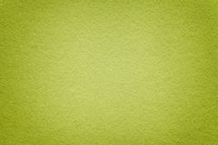 Texture of old green paper background, closeup. Structure of dense light olive cardboard. Texture of old olive paper background, closeup. Structure of dense royalty free stock photography