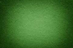 Texture of old green paper background, closeup. Structure of dense light olive cardboard. Texture of old olive paper background, closeup. Structure of dense dark stock photography