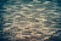 Texture of old grunge brick wall background. Cross process and v Royalty Free Stock Image