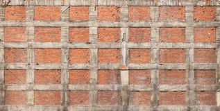 Texture of old house wall made of red bricks and concrete Royalty Free Stock Image