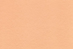 Texture of old light coral paper closeup. Structure of a dense cardboard. The peach background Royalty Free Stock Image