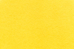 Texture of old light yellow paper background, closeup. Structure of dense lemon cardboard Royalty Free Stock Photo