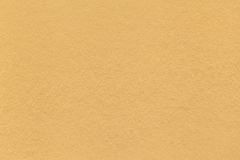 Texture of old light yellow paper closeup. Structure of a dense cardboard. The golden background Royalty Free Stock Image