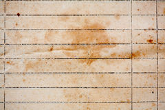 Texture of old lined yellow paper. Texture of the old, lined, yellowed paper with shabby brown spots Stock Photography