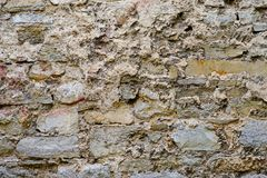 Texture of old medieval castle wall made from gray stones Royalty Free Stock Image
