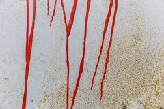 Texture of old metal container with stains from red paint. Backdrop Stock Images