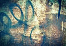 Texture of old metal garage wall rust stains graffiti grunge. Old metal wall garage stains, rust, peeling paint Grand graffiti in black paint Stock Image
