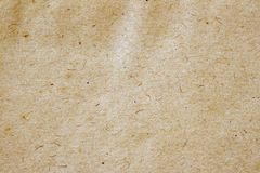 Texture of old moldy paper with dirt stains, spots, inclusions cellulose, brown cardboard texture background, grunge. Texture of very old moldy paper with dirt royalty free stock image