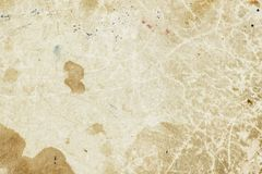 Texture of old moldy paper with dirt stains, spots, inclusions cellulose, brown cardboard texture background, grunge. Vintage backdrop royalty free stock images