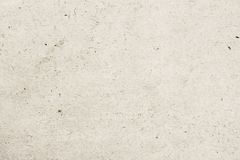 Texture of old organic light cream paper with wrinkles, background for design with copy space text, image. Recyclable stock photo