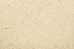 Texture of old organic light cream paper with wrinkles, background for design with copy space text or image. Recyclable stock photo