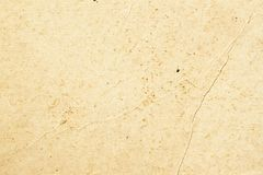 Texture of old organic light cream paper with wrinkles, background for design with copy space text or image. Recyclable royalty free stock images