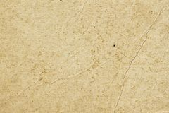 Texture of old organic light cream paper with wrinkles, background for design with copy space text or image. Recyclable royalty free stock photo