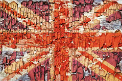 The texture of old paint, crackles with the image of the Union Jack.  stock photo