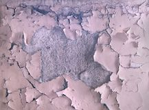 The texture of the old paint peeling on the stone wall. Background of exfoliation dye. stock photo