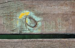 Texture of old painted boards. Closeup of wooden mooring pier with green and yellow paint Royalty Free Stock Image