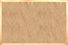 Texture of the old paper in a frame in the background. Old paper in frame as background Royalty Free Stock Photography