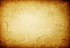 Texture of old paper with zodiac signs. Stock Image