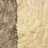 Texture of old parchment and sand Stock Image